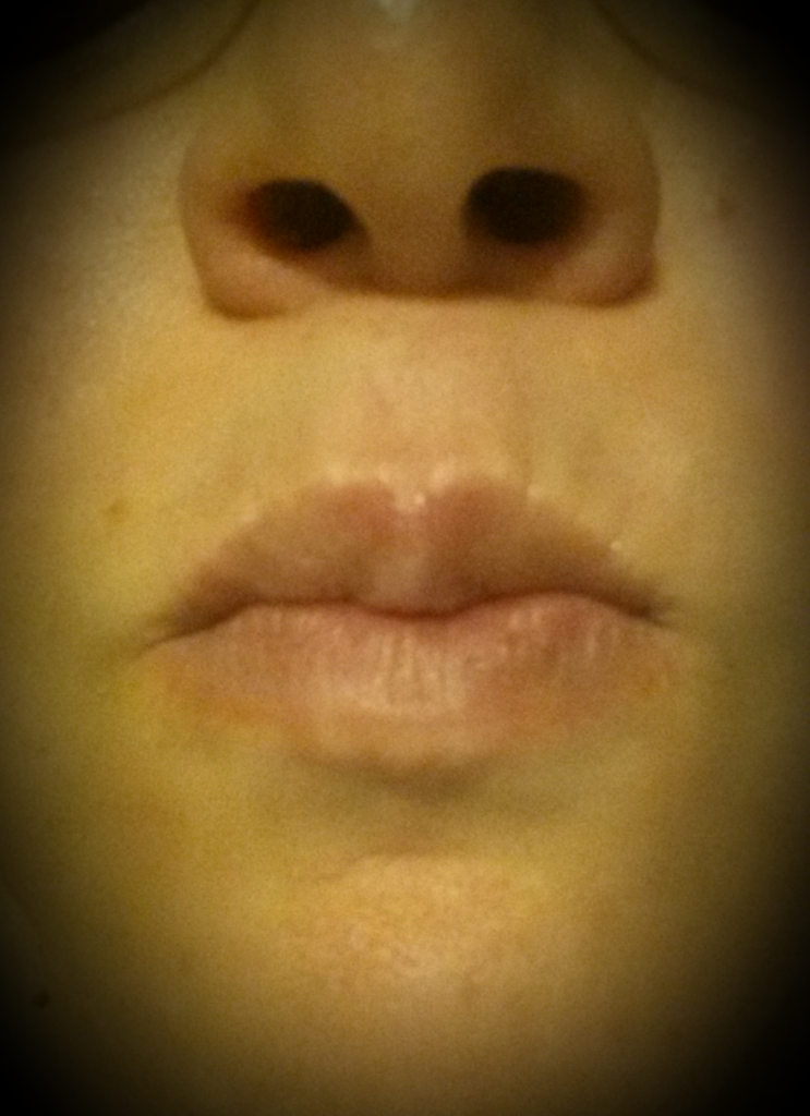 That's my mouth... filled with Coconut Oil.... Its happening as I type